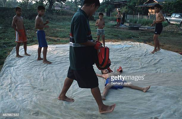 A young boxer practices in the early morning at camp Sangsillee near Mae Sot Khun Litichai his father who is a policeman and a former Bangkok boxer...