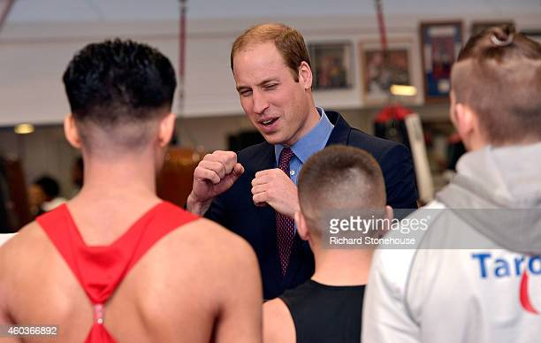 Young Boxers chat with Prince William Duke Of Cambridge during an official visit to formally open the Holford Drive Community Sports HUB on December...