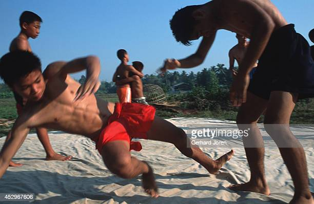 Young boxers wrestle in the early morning at camp Sangsillee near Mae Sot Khun Litichai who is a policeman and a former Bangkok boxer trains them...