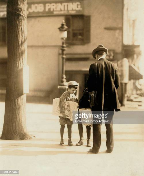 Young Boy 7 years old Selling Newspapers on Street Wilmington Delaware USA Lewis Hine for National Child Labor Committee May 1910