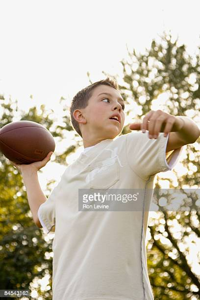 Young boy about to pass a football