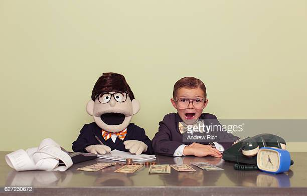 young boy accountant and puppet associate - vintage stock stock pictures, royalty-free photos & images