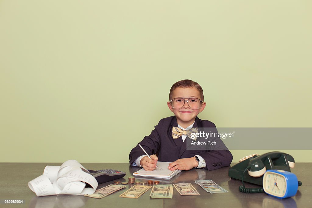 Young Boy Accountant Records Taxes to be Paid : Stock Photo