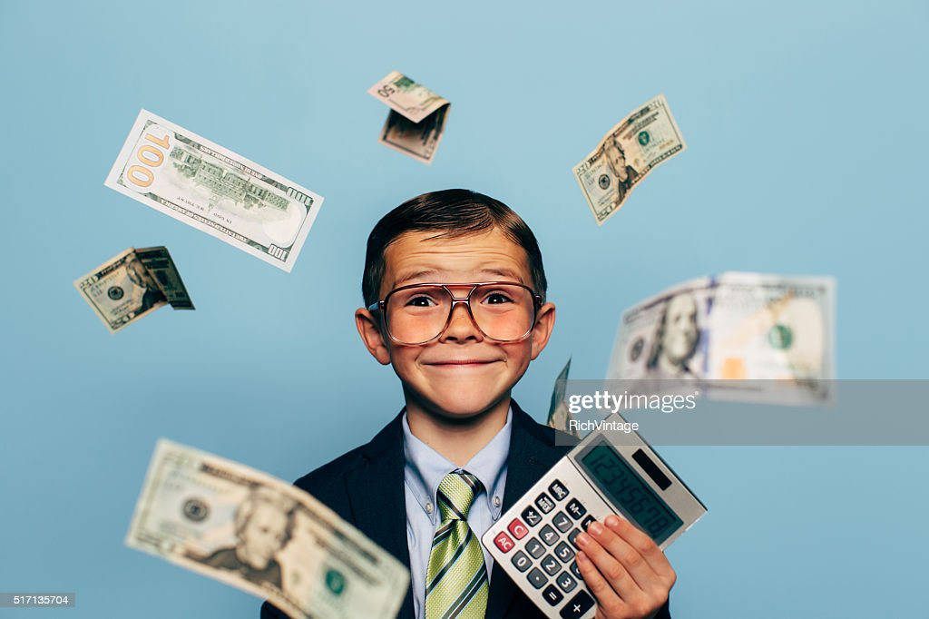 Young Boy Accountant Wearing Glasses holding Calculator : Stock Photo