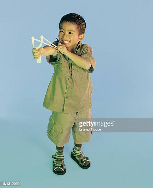 Young Boy Aiming a Catapult