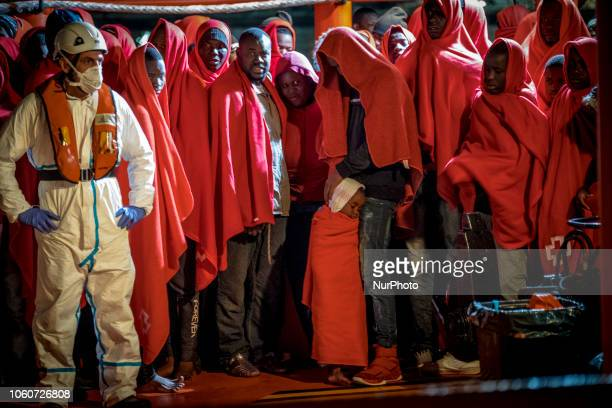 A young boy among adults waiting onboard the Spanish vessel to be transferred to the Red Cross tent On 11 November 2018 in Malaga Spain The Maritime...
