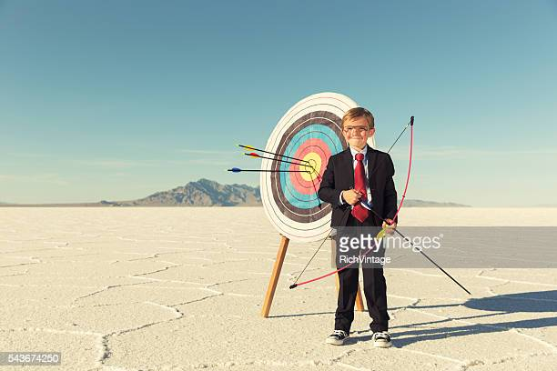 Young Boy and Business Archer With Target