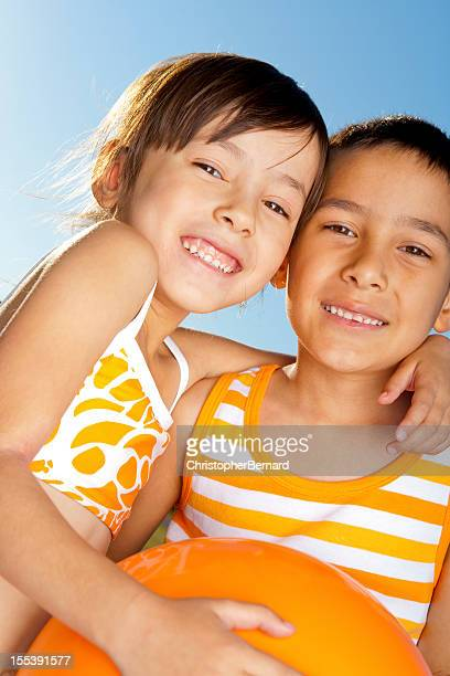 Young boy and girl adhesión