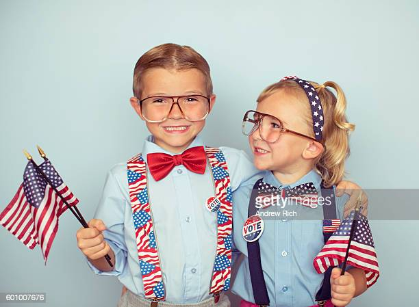 young boy and girl couple with american flags - presidential election stock pictures, royalty-free photos & images