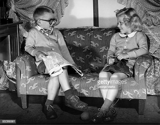 young boy and girl dressed like adults - girls with short skirts - fotografias e filmes do acervo
