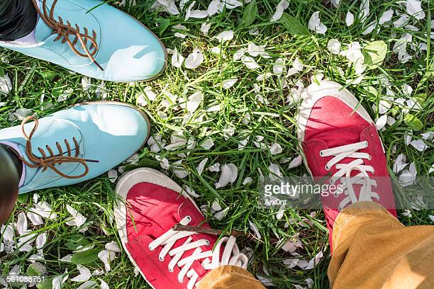 Young boy and girl in park, feet