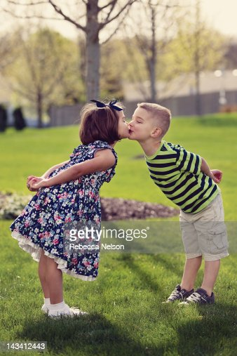 Young Boy And Girl Leaning In And Kissing Stock Photo -4183