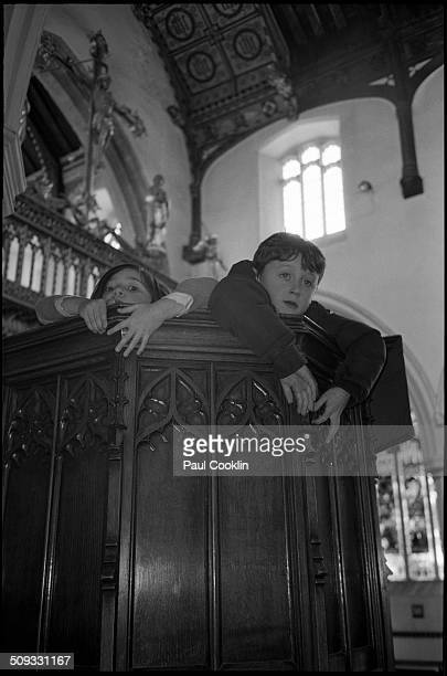 Young boy and girl on church pew