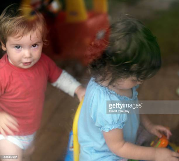 young boy and girl playing - crausby stock pictures, royalty-free photos & images