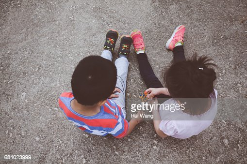 Young boy and girl playing together