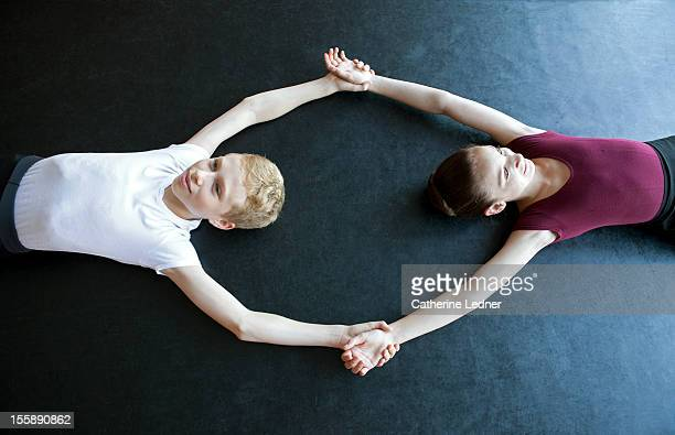 A young boy and girl practicing ballet