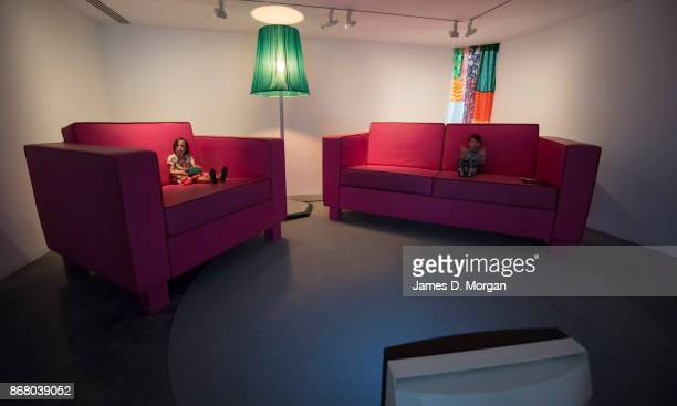 A young boy and girl sit in Das Zimmer at the opening of Pipilotti Rist's sensory exhibition 'Sip my Ocean' at the Museum of Contemporary Art on...