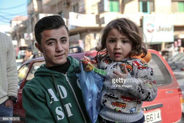 A young boy and girl stand outside a Syrian refugee centre in Mafraq close to the SyrianJordanian border The areas population is now half refugees...