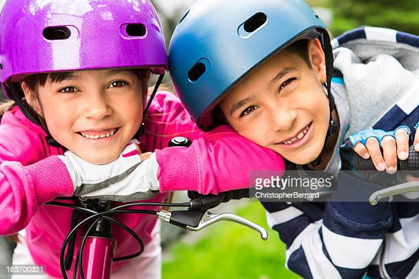 Young boy and girl taking a break on their bikes