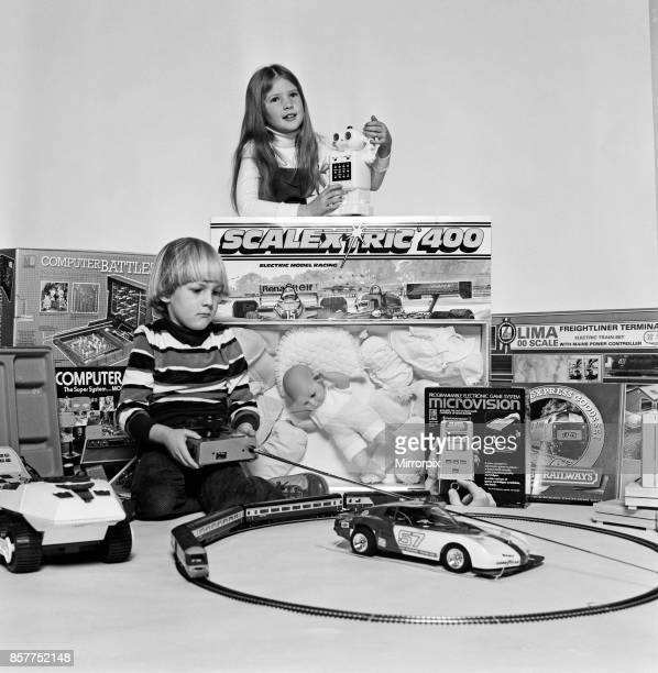 A young boy and girl with a selection of children's toys for Christmas December 1980