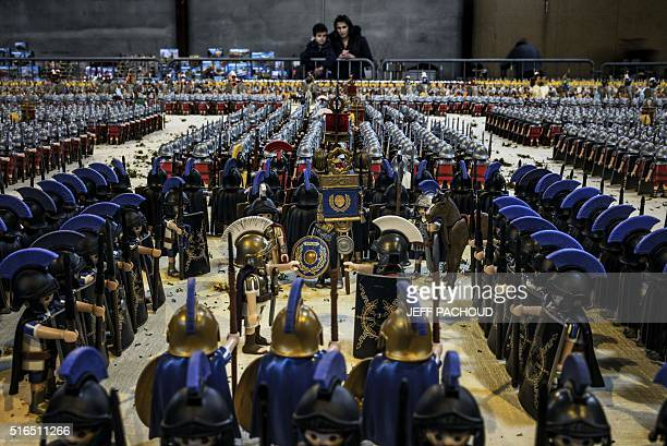 A young boy and his mother look at a Playmobil diorama displaying the Battle of Zama fought in 202 BC consisting of more than 26000 figures at the...