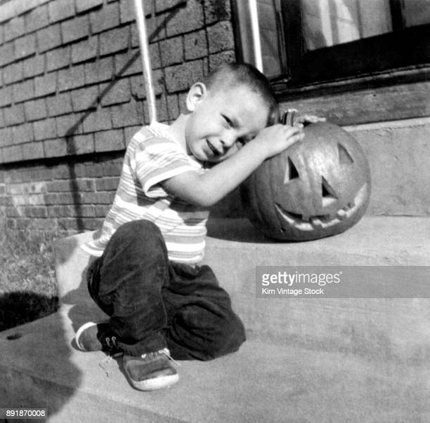 Young boy and his pumpkin, ca. 1965.