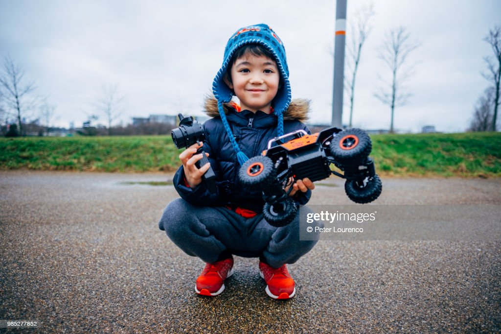 Young boy and his remote controlled car : Stock Photo