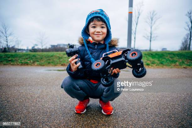 Young boy and his remote controlled car