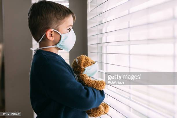 young boy and his teddy wearing face masks - shielding stock pictures, royalty-free photos & images