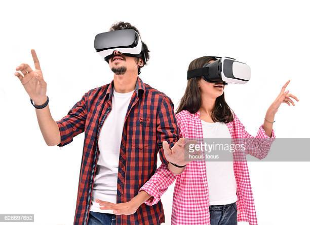 Young boy and little girl  experience with VR headset