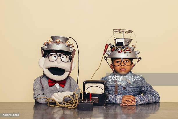 Young Boy and Puppet Dressed as Nerds Testing Telepathy