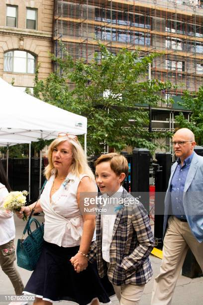 A young boy arriving with his parents arriving to the 9/11 Memorial Ceremony