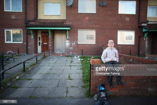 Young boy asks passers-by for 'a penny for the guy'outside his council home in Salford on October 20, 2010 in Manchester, England. The Chancellor of...