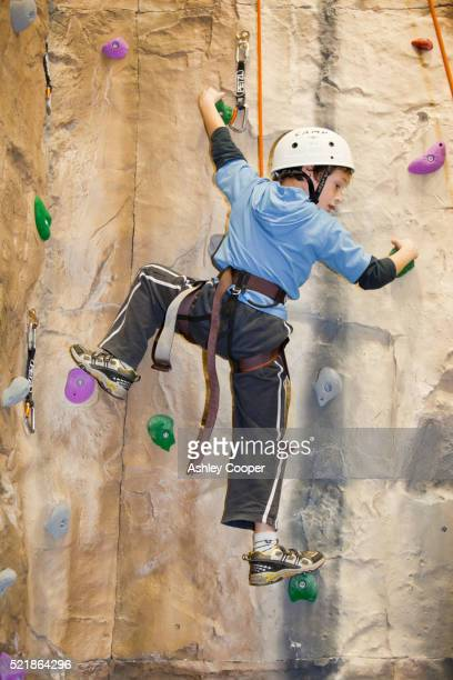 A young boy at a climbing wall in Ambleside, Lake District, UK.