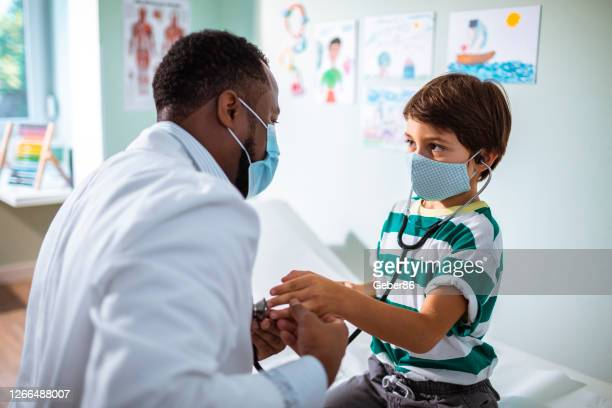 young boy at a pediatric office - pediatrician stock pictures, royalty-free photos & images