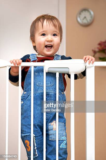 Young boy at a stair gate