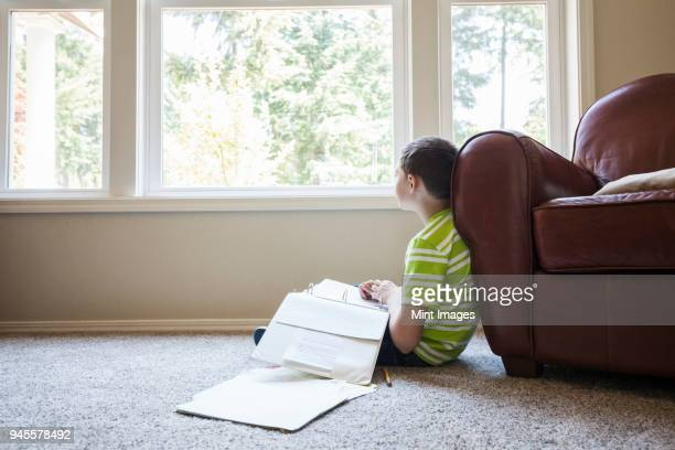 Young boy at home doing homework.