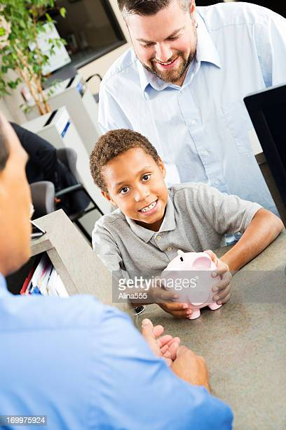 Young boy at the bank with his father
