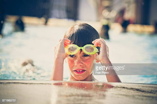 Young boy at the pool with goggles