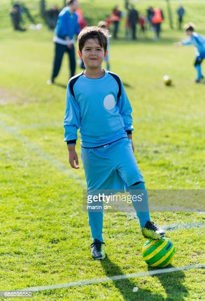 Young boy at the stadium playing kids' soccer