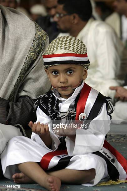 A young boy attends Friday prayers with supporters of Yemeni President Ali Abdullah Saleh at alSaleh mosque in Sanaa on June 17 as a top Saudi...