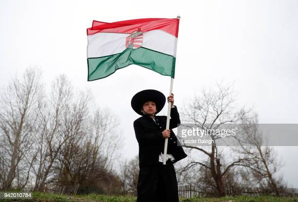 A young boy attends the reenactment of the Battle of Tapiobicske on April 4 2018 near Cegled Hungary The 1848 battle was an effort by the Hungarian...