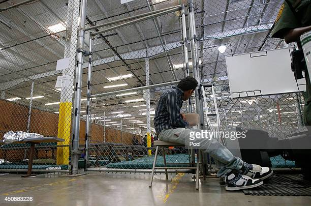 A young boy awaits medical treatment as he sits outside his holding area where hundreds of mostly Central American immigrant children are being...