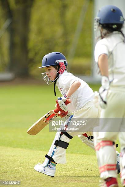 Young Boy Batting