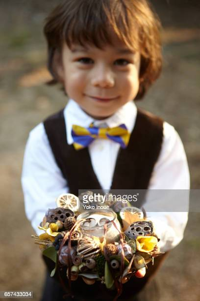 Young boy bearing rings for a wedding