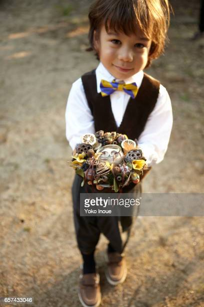 young boy bearing rings for a wedding - ring bearer stock pictures, royalty-free photos & images