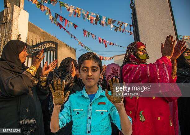 Young boy being covered with henna during a wedding ceremony on December 29 2015 in Kushkenar Hormozgan Province Iran