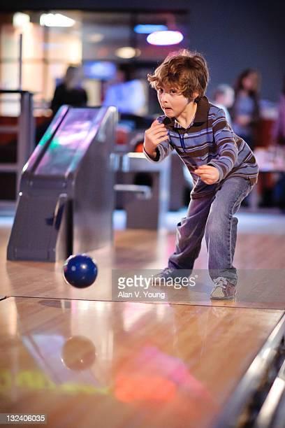 Young boy bowling five pin