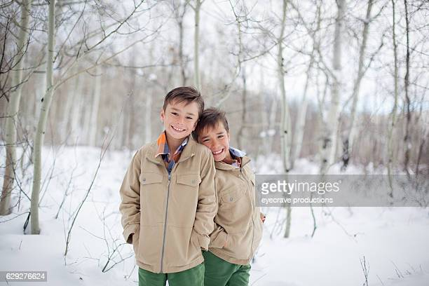 Young Boy Brothers Outdoors in Winter Deep Snow