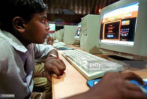 A young boy browses the Internet at a cybercafe in Bangalore 25 November 2000 in the city long been touted as India's Silicon Valley Industry...